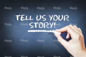 stock-photo-59004934-tell-us-your-story-text-on-blackboard1